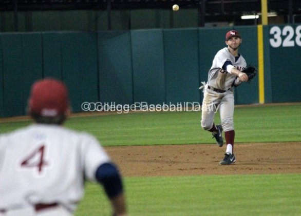 Joey Boney throws to first base.