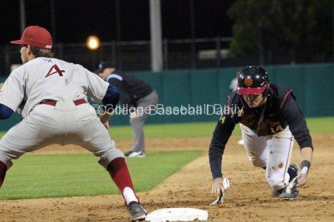 Vahn Bozoian dives back to first base.
