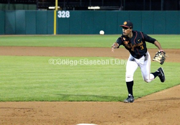Dante Flores flips to the pitcher.