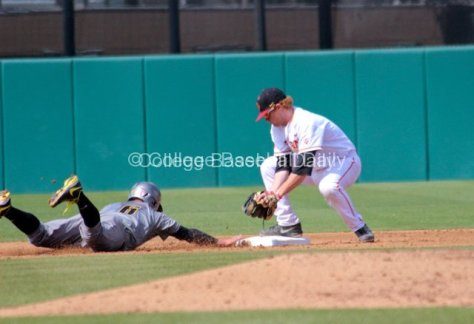 Adam Landecker tries to apply the tag.