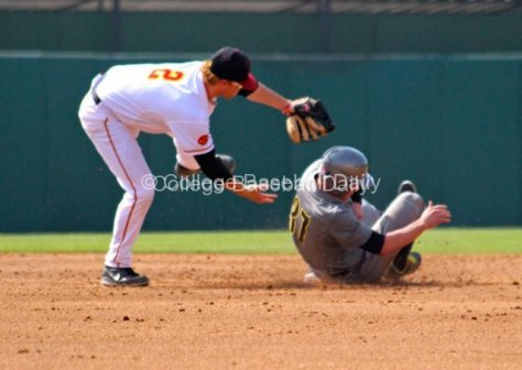 Adam Landecker avoids the sliding Mitchell Tolman.