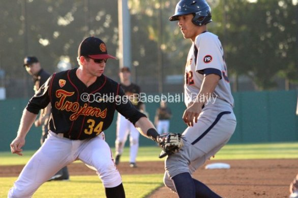 Kevin Swick applies the tag to Chris Amezquita.