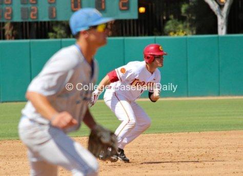 Greg Zebrack takes off for third base.