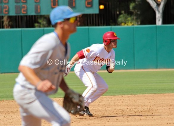 Greg Zebrack takes off for third base.
