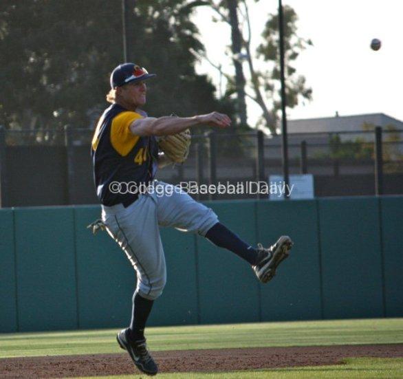 Mitch Delfino makes an off-balance throw.