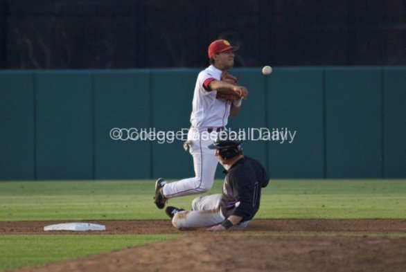 Andres Rodriguez turns the double play.