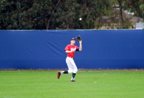Wyler Smith runs down a ball in CF.