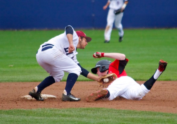 Wyler Smith is hosed at 2B. David Fletcher applies the tag.