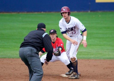 Kody Davis shows the ball. Cassidy Brown looks on as he's called out.