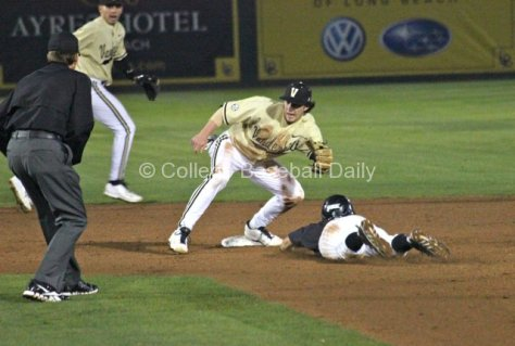 Garrett Hampson dives into second base as Dansby Swanson applies the tag. (Photo: Shotgun Spratling)