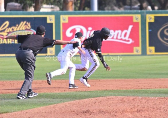 Zack Domingues applies the tag in a rundown. (Photo: Shotgun Spratling)