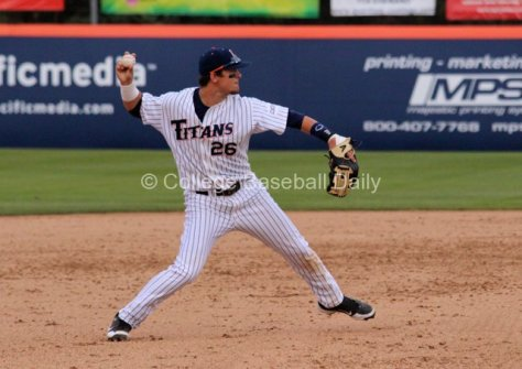 J.D. Davis makes a play at third base.