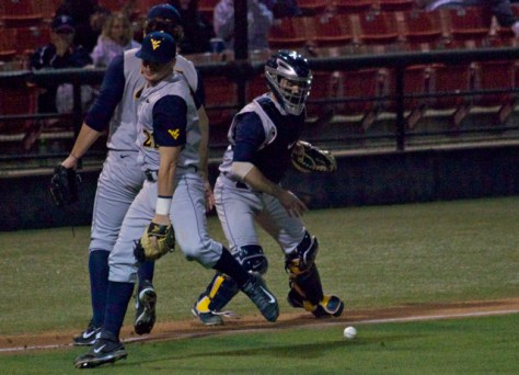 West Virginia muffs a bunt.