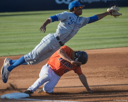 UCSB 3rd baseman Tevin Mitchell dives for an errant throw from his catcher as Scott Hurst slides into 3rd base on a wild pitch. CSUF defeated UCSB 8-4, Fullerton, CA, May 12, 2017.