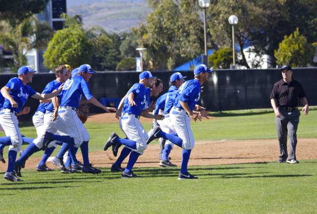 The-UC-Santa-Barbara-dugout-explodes-onto-the-field