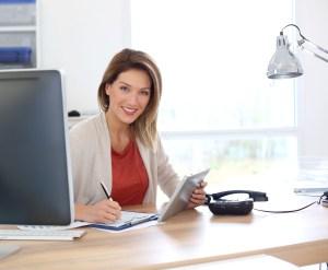 Woman happy at desk
