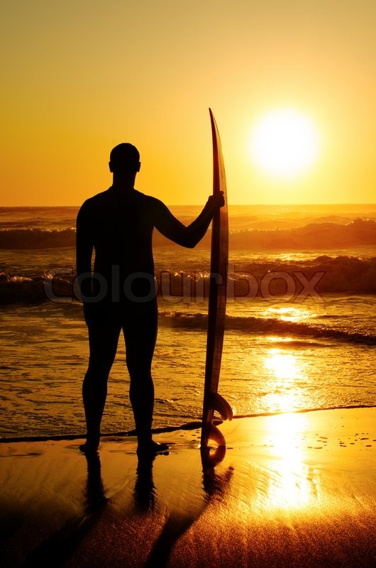 Surfer Girl Bali Wallpaper A Surfer Watching The Waves At Sunset In Portugal Stock