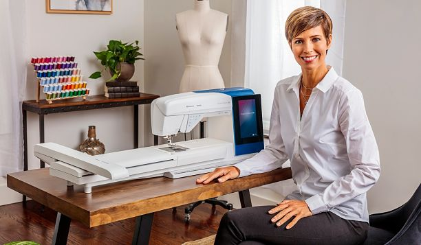 DESIGNER BRILLIANCE 80 model standing with machine with embroidery