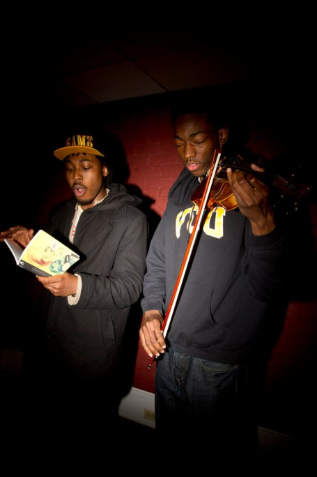 Rob Gibson and Eric Stanley work together to perform Gibson's spoken-word poetry while Eric Stanley plays violin. Photo  by photo by ZoË Dehmer