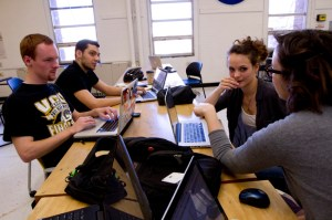 Guerrilla Web students work together to learn web design during their collaborative class sessions. The students come together weekly to teach themselves  web skills. Photo by Zoe Dehmer