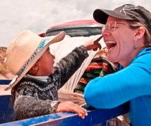 Young Peruvian boy and Amy Colvin share a moment of loving kindness