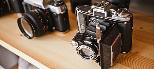 Cameras-ByJeffSheldon-Unsplash-525x235