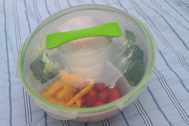 4-pc Colander/Bowl set includes one 25.3-cup bowl with matching spill proof cover, removable colander and covered dip container.