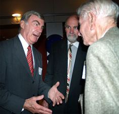 Sam Donaldson talks to colleagues