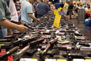 Federally licensed dealers must still run background checks on buyers, even at gun shows like this one.