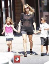 Heidi Klum - walking in Manhattan. Johan appears to have ...