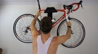 This sculptural bike wall mount is designed to display ...