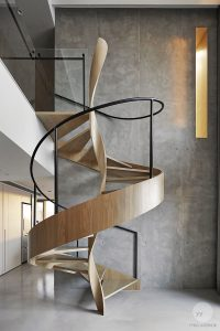 A Sculptural Spiral Staircase Makes A Statement In This ...