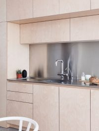 Light wood cabinets with stainless steel countertops and ...