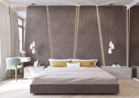 The angular upholstered headboard in this modern bedroom ...