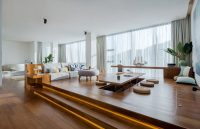 Raised Platforms Help To Make This Open Plan Apartment ...