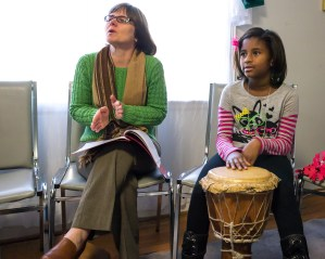 Singing and drumming during the sharing session after classes on Sunday morning.