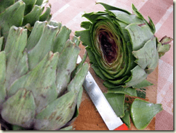 artichokes being prepared for cooking