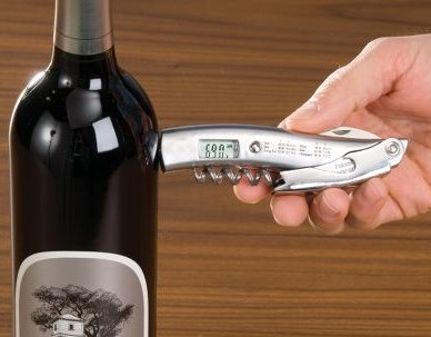 Infrared Thermometer And Corkscrew.