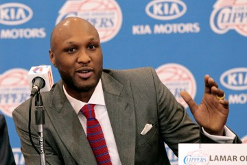 Basketball player Lamar Odom speaks at a news conference announcing his acquisition by the Los Angeles Clippers in Los Angeles, California in this file photo taken July 2, 2012. Odom was arrested early on Friday on suspicion of driving under the influence after police noticed his Mercedes SUV was driving erratically on a Los Angeles highway, authorities said.  REUTERS/Mario Anzuoni/Files   (UNITED STATES - Tags: SPORT BASKETBALL CRIME LAW)