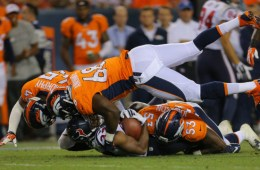 DENVER, CO - AUGUST 23:  Running back William Powell #33 of the Houston Texans is tackled behind the line of scrimmage in the fourth quarter by defensive end Kenny Anunike #68 and defensive back Jerome Murphy #45 of the Denver Broncos during a preseason game at Sports Authority Field at Mile High on August 23, 2014 in Denver, Colorado.  (Photo by Justin Edmonds/Getty Images)
