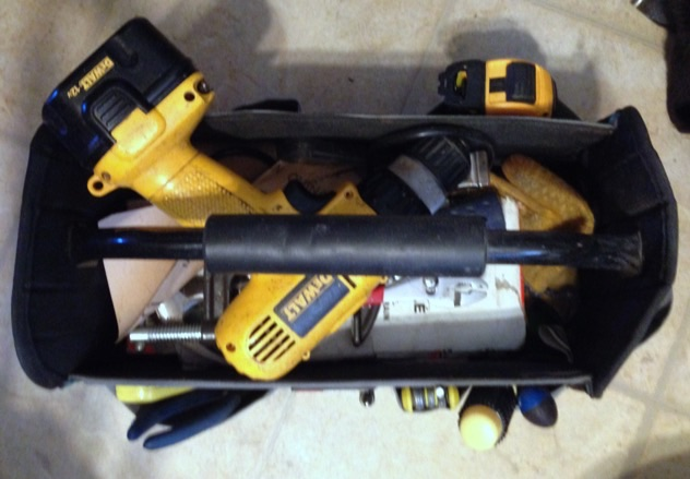 i keep everything handy for quick daily stuff:: drill, hammer, measure ... THE GOOD SCISSORS ...