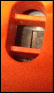 Semi-ovoid screw, found on left side of Black & Decker power saw; this needs to fit into the same-shape on the blade.