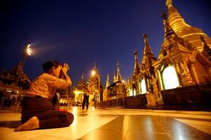 A woman prays at the Shwedagon Paya in Yangon