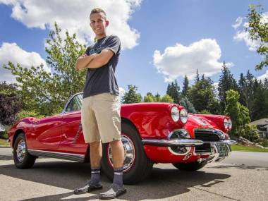 """Blake Nelson stands near his 1962 Corvette in the driveway of his family's home in Puyallup. Nelson inherited the car from his grandfather, Paul Gaetz, after he died from brain cancer in 2009. """"It's cool having something that reminds me of him all the time,"""" he said. Joshua Bessex jbessex@gateline.com  Read more here: http://www.thenewstribune.com/news/local/community/puyallup-herald/ph-news/article90530867.html#storylink=cpy"""