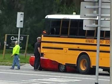Corvette Driver Nearly Gets His Head Chopped Off Driving Under a School Bus in Brooksville, Florida.