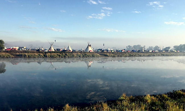 Sunrise on the Cannonball River and the Oceti Sakowin camp, Standing Rock Sioux Reservation. Photo by Thane Maxwell.