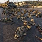 Clothes, weapons and tanks are abandoned on the Bosporus Bridge in Istanbul. (Gokhan Tan/Getty Images)