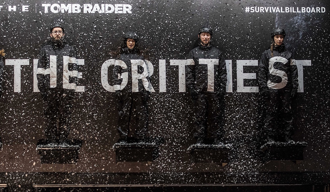 Xbox Rise of the Tomb Raider Survival Stunt Tortures Fans Strapped To A Billboard Guerrilla Marketing Photo