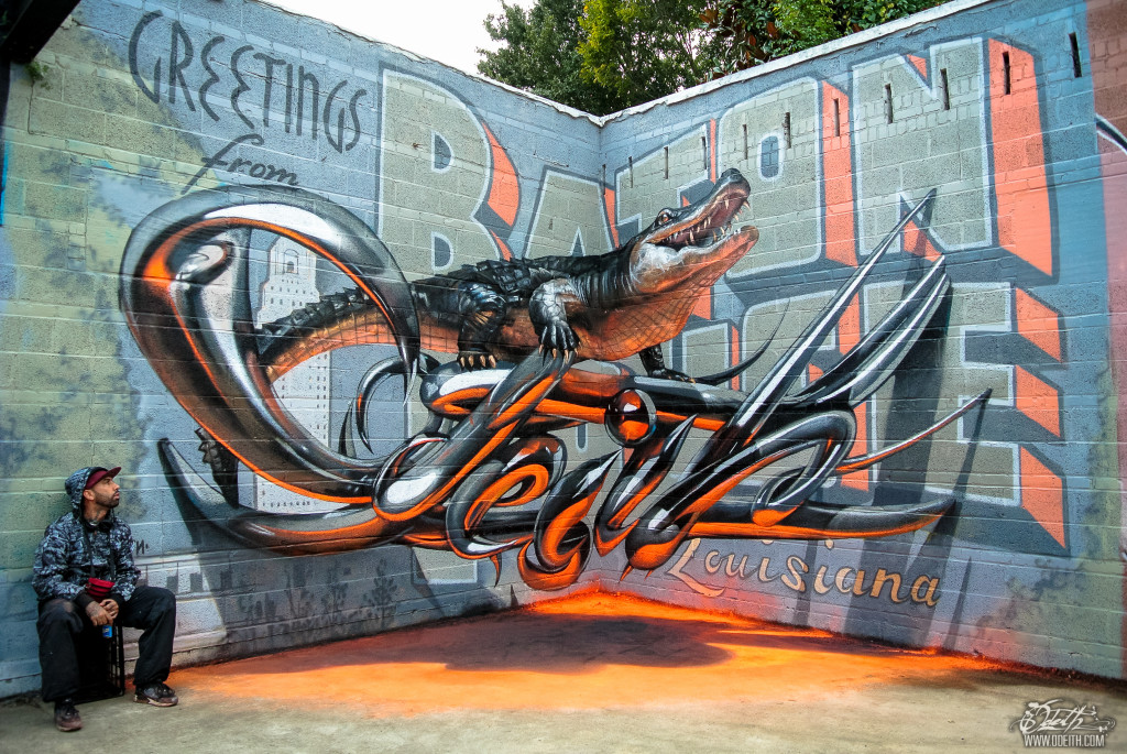 Odeith-aligator-stading-on-Anamorphic-3d-chrome-letters-Greetings-from-Baton-Rouge