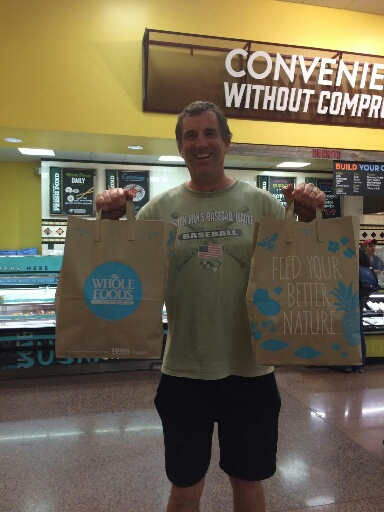 Man holding two bags groceries
